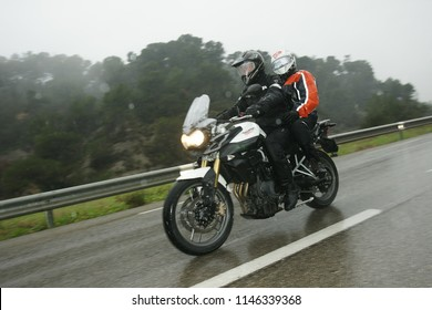 driving a motorbike in rainy weather with a passenger around Nice, Provence-Alpes-Côte d'Azur/France - January 6 - 2011