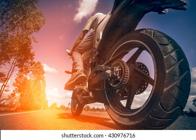 Driving a motorcycle in a sunny day.
