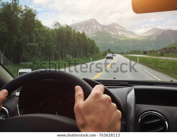 driving in Norway, scenic beautiful road seen from the car window, vintage filter