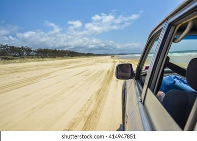 Driving on 75 Mile Beach on Fraser Island, Queensland, Australia