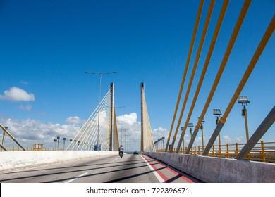 driving on the bridge Newton Navarro