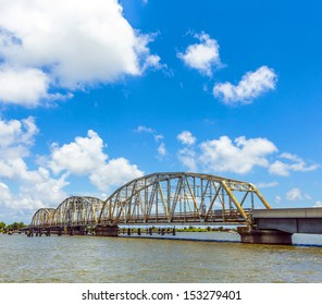 driving on Chef Menteur Highway with old bridge in East area of New Orleans crossing the bay