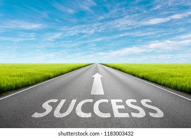 Driving on an empty asphalt road through the green agricultural fields at idyllic sunny day. Business concept for the success.