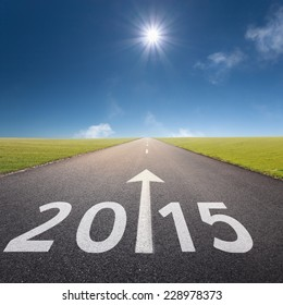 Driving on an empty road forward to New Year at idyllic sunny day - concept for success