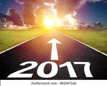 Driving on an empty road and happy new  year 2017 concept