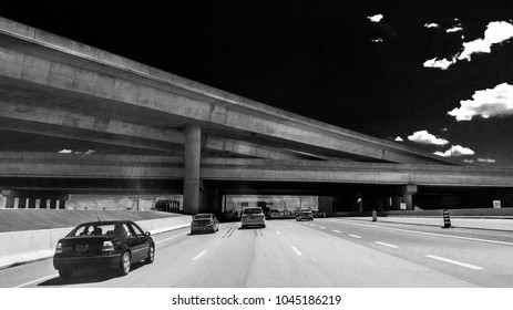 driving on a highway in black and white