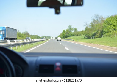 Driving on a highway that goes through a beautiful countryside in springtime