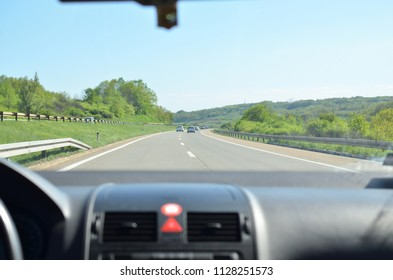 Driving on a highway that goes through beautiful countryside in spring