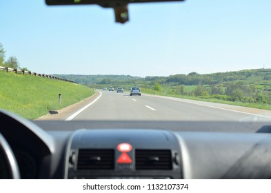 Driving on a highway that goes through a beautiful countryside