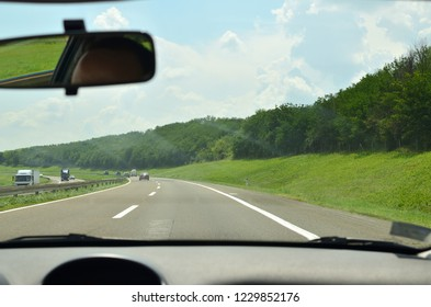 Driving on a highway that goes through beautiful countryside in summertime