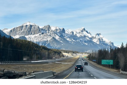 Driving on highway through Canadian Rocky Mountains near Canmore, Alberta