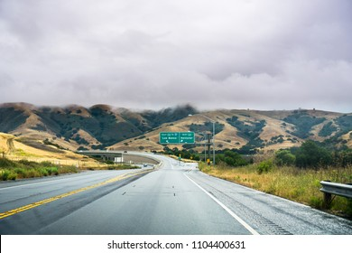 Driving on the highway through the hills of south San Francisco bay area on a cloudy day, California