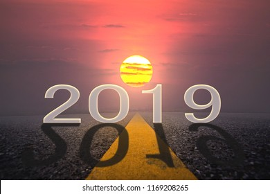 Driving on idyllic open road against the setting sun forward to new year 2019. Concept for success and future,Happy New Year 2019