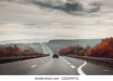 Driving on the motorway on a dark moody day with autumn colorful leaves. Okertal, Oker gorge, Oker National Park Harz, Harz Mountains, Germany