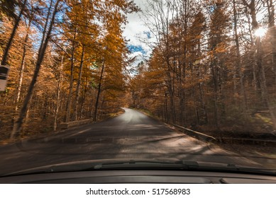 Driving on mountain road with autumn landscape