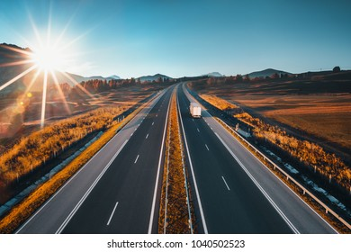 Driving on open road at beautiful sunny day. Aerial drone view