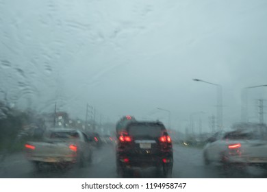 Driving on a rainy day, looking from the windshield. Danger is very cautious with blur vission