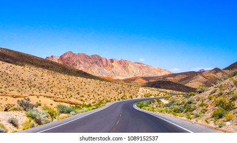 Driving on the road in the desert