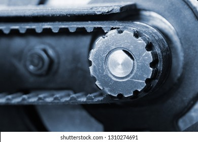 Driving pulley and toothed belt close up