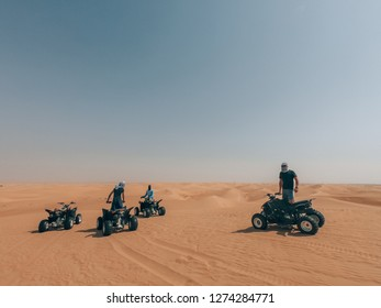 driving quad in the desert of dubai
