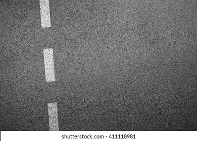 Driving road with separation line, asphalt surface from top view