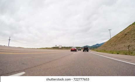Driving in rural area of Western Colorado on cloudy day.