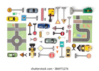 driving school concept. set of road signs and cars on white background top view