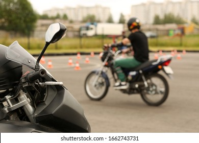 Driving school driving lessons. Motorcyclist on a bike. A young man learns to drive a motorcycle.