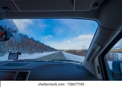 Driving through Alaska Dalton Highway view from inside of a car