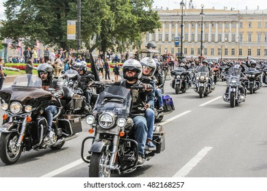 Driving through a group of bikers. St. Petersburg, Russia - 13 August, 2016. The annual parade of Harley Davidson in the squares and streets of St. Petersburg.