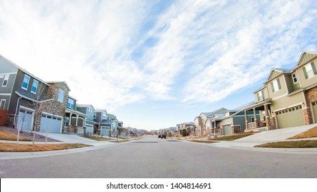 Driving through new residential neighborhood in suburbia.