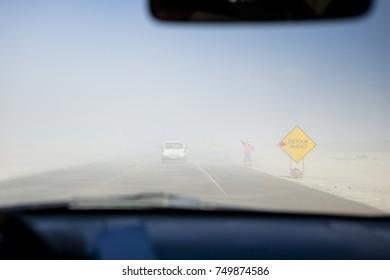 Driving through a sandstorm on the Abu Dhabi, United Arab Emirates