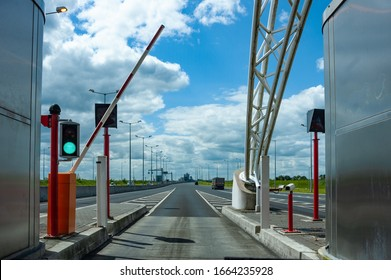 Driving through toll booth on the highway