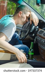Driving Under the Influence. Man sleeping on the steering wheel.