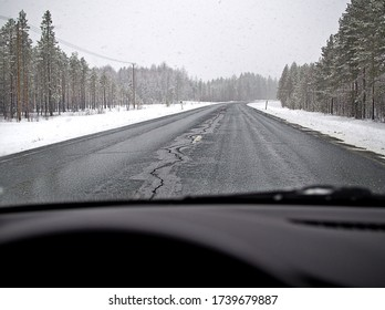 Driving in very slippery and dangerous conditions on frozen and snow covered road in Finnish winter.