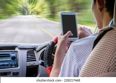Driving while holding a mobile phone (cell phone use while driving)
