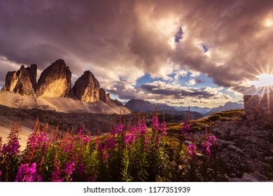 Drmatic sunset light and colors at Tre Cime di Lavaredo, in summer