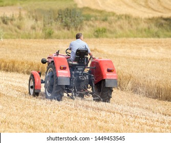 Drnholec, Czech Republic, July 5, 2019, Man riding on old tractor