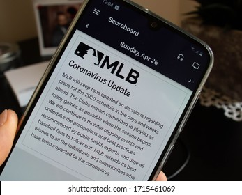 Dro, Italy - 04 27 2020: A frustrated MLB fan is checking on the MLB app the season calendar and seeing that there are no scheduled mathces because the baseball season is suspended