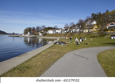 DROBAK, NORWAY - MAY, 2. Some teens meet at the sunbathing area at Drobak (Akershus, Norway) directly beneath the Oslo Fjord on May 2, 2017.