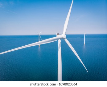 droen view aerial view at the blue ocean with white windmills, wind mill farm green energy