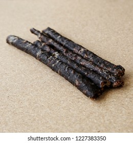 Droewors (biltong) on a wooden board, this is a traditional food snack that can be found in South Africa.