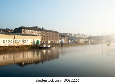 DROGHEDA, IRELAND - MARCH 11, 2014: A view of buildings along the River Boyne early in the morning in Drogheda, Ireland on March 11, 2014.