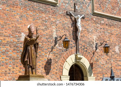 Drohobych / Ukraine - july 9, 2019: monument to Pope John Paul II in front of the central entrance to the church of St. Bartholomew