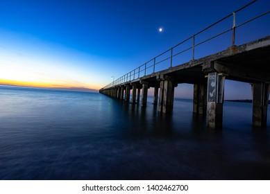 Dromana pier at sunset with blue sky