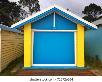 Dromana Public Foreshore bathing box, yellow with a blue door