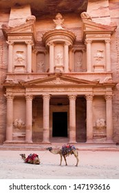 Dromedaries (Camelus dromedarius), waiting for tourists at Al Khazneh (the treasury), probably built 2nd-3d Century AD. Most famous building of ancient Nabatean city of Petra, Jordan.