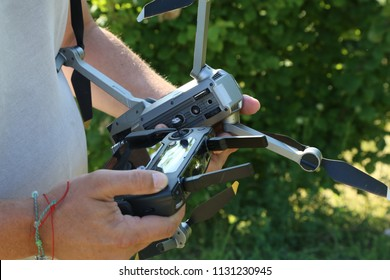 Dron in the hands of man