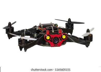 Dron quadrocopter isolated on white background. Remote controlled dron quadrocopter flying with digital camera. Closeup. New tool for aerial photo and video. Copter