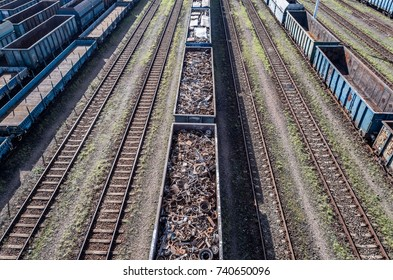 Drone above view on railway wagon filled with scrap metal. Metal recycling